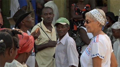 Rose-Marie Chierici speaks to patients at mobile clinic in Haiti