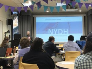 Professor Paul Schacht welcomes attendees of the NYDH Symposium